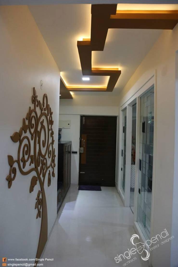 kishore residence :  Corridor & hallway by single pencil architects & interior designers ,Modern