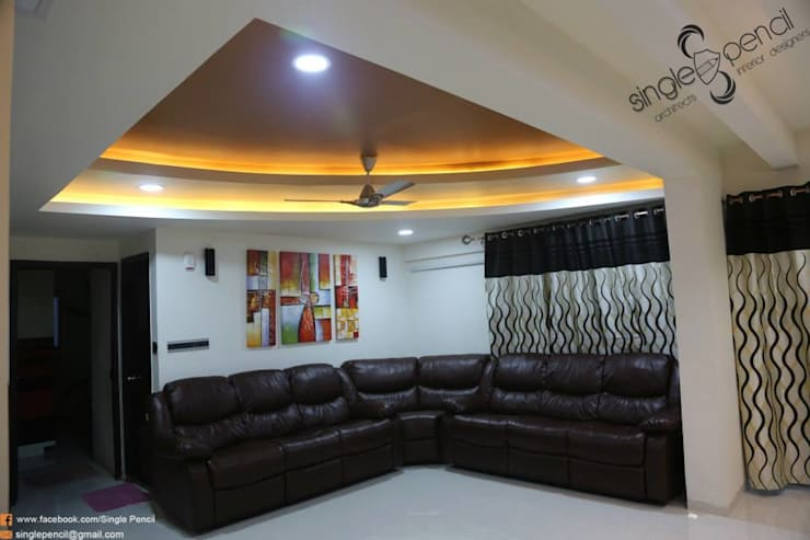 kishore: modern Living room by single pencil architects & interior designers