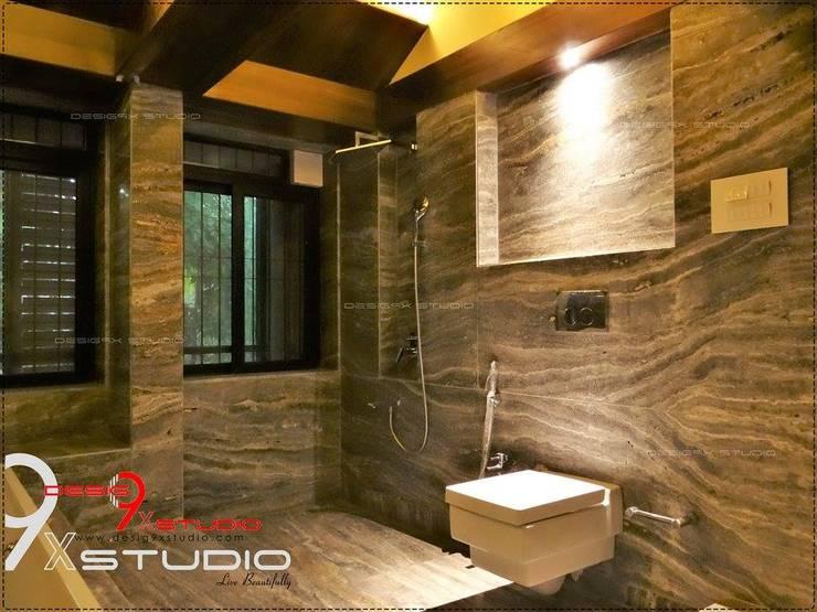 Bathroom designs:  Bathroom by Desig9x Studio