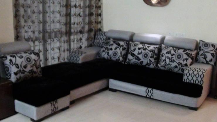 Miyapur Apartment: modern Living room by wynall interiors