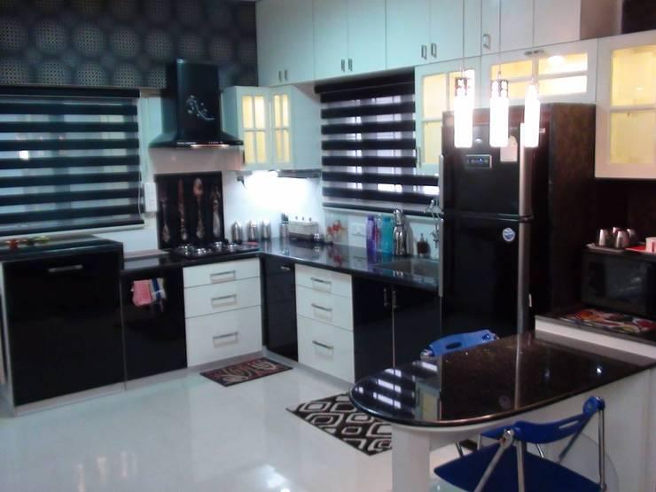 Miyapur Apartment: modern Kitchen by wynall interiors