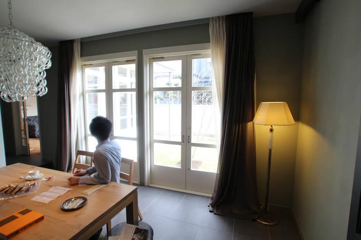 Antique Gate House: Sakurayama-Architect-Designが手掛けたダイニングです。