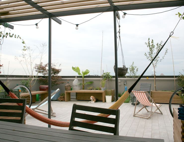 Terrazas de estilo  por Atelier delle Verdure