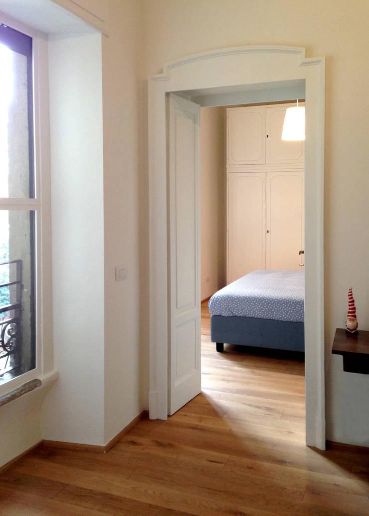 Corridor & hallway by Atelier delle Verdure, Minimalist