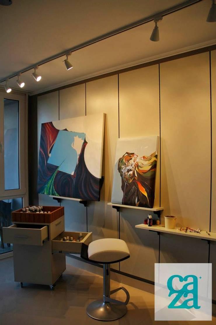 DEPARTAMENTO Y ATELIER: Dormitorios de estilo  por caza Studio