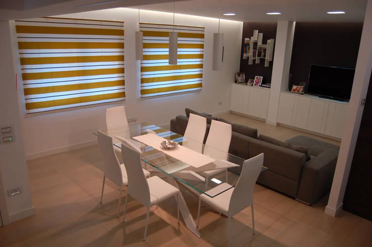 Dining room by Archideo Studio di Architettura