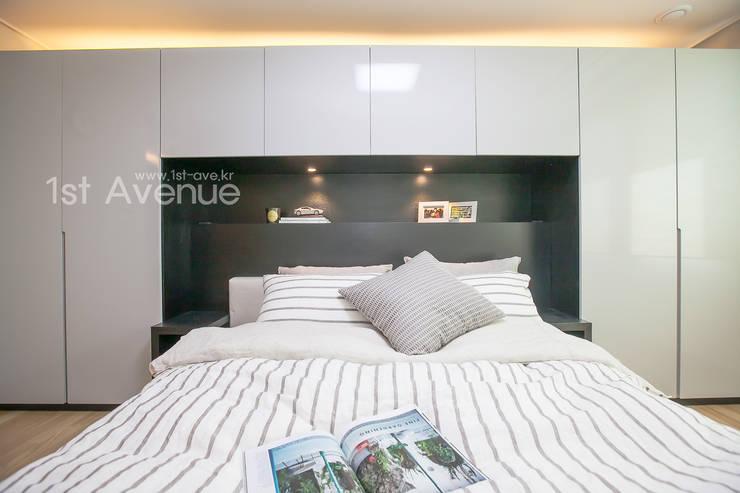 은은한 고급스러움을 표현한 녹번동 인테리어: 퍼스트애비뉴의  침실