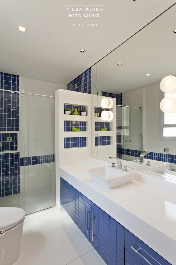 Banheiro Masculino: Banheiros  por Nilza Alves e Rita Diniz,Moderno