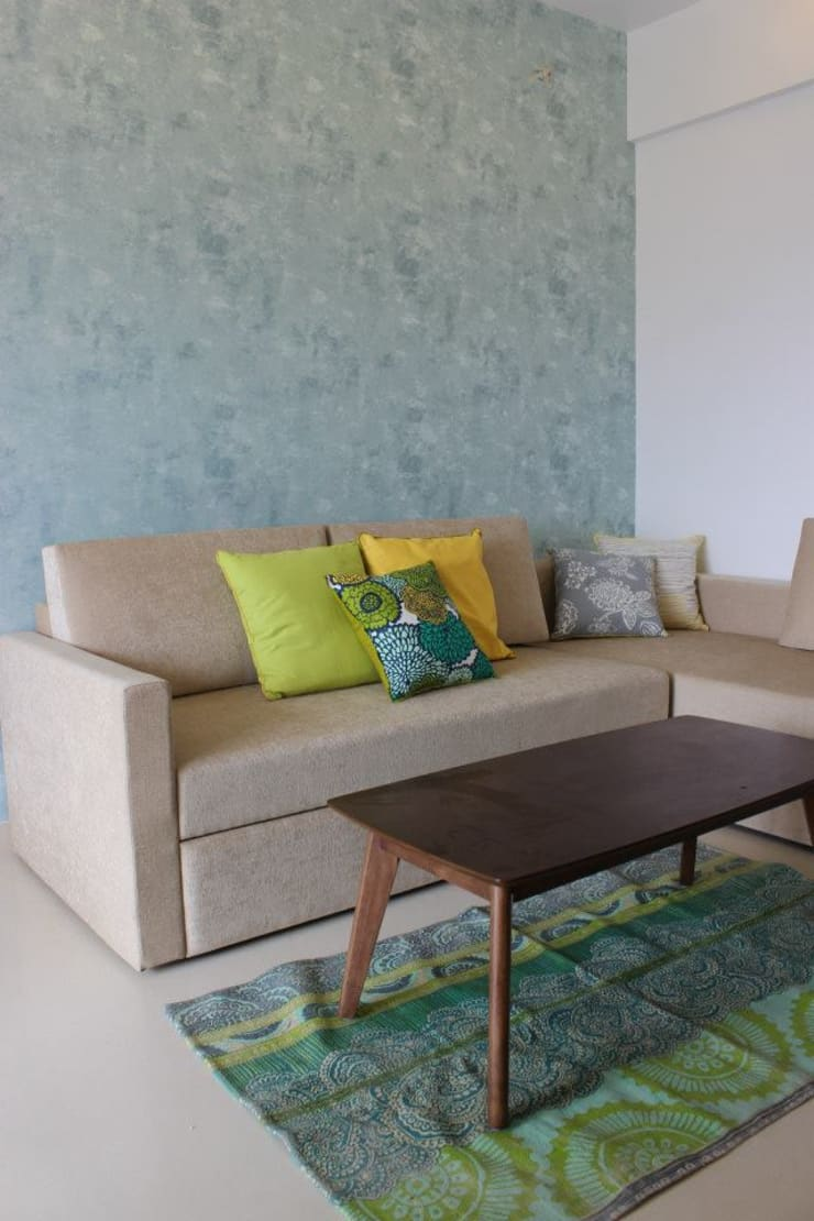 Thane Apartment.:  Living room by The design house