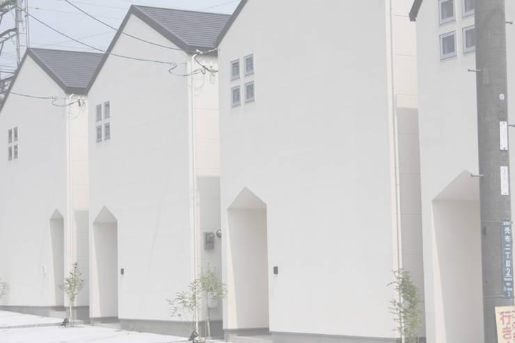 Casas de estilo ecléctico de 株式会社K's建築事務所 Ecléctico