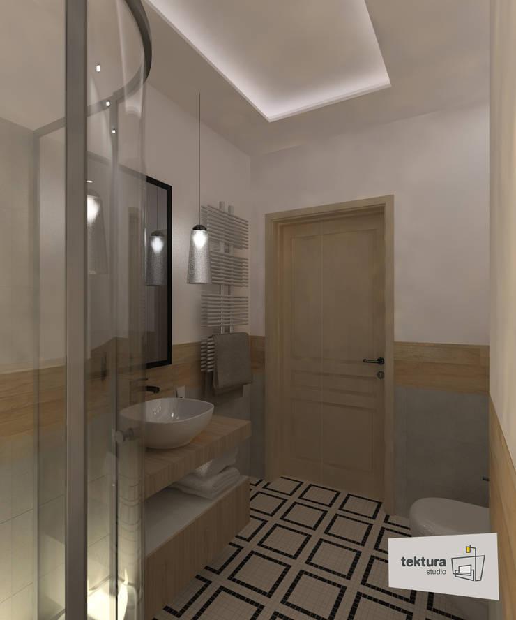 mała łazienka z zaakcentowaną posadzką: styl , w kategorii  zaprojektowany przez Tektura Studio