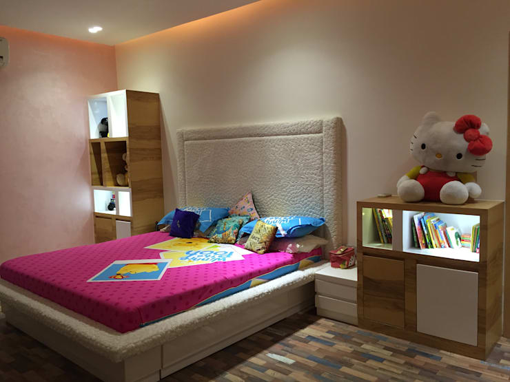 Residence - Mr. Bansal's daughter's room:  Bedroom by Ujjval Fadia Architects & Interior Designers