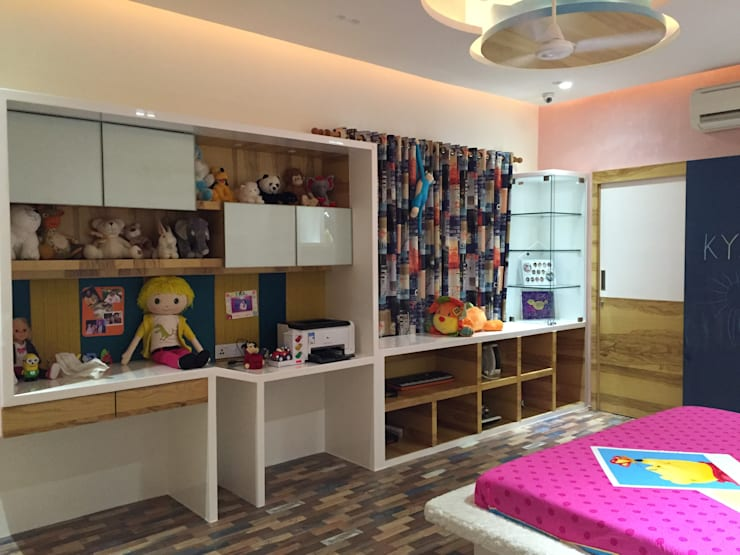 Residence—Mr. Bansal's daughter's room:  Bedroom by Ujjval Fadia Architects & Interior Designers