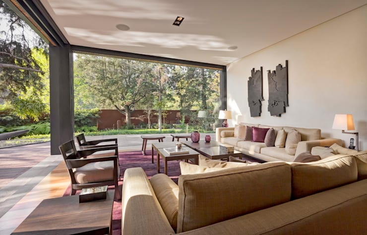 Casa JRQZ : Salas de estilo  por Lopez Duplan Arquitectos