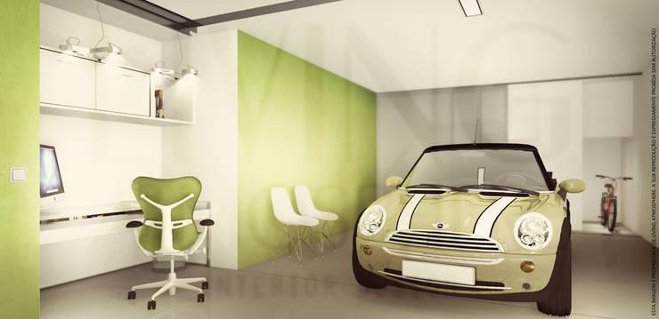 Garagem: Garagens e arrecadações modernas por Living Atmosphere