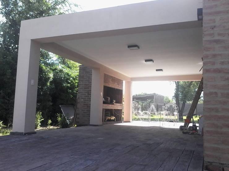 Asador antes y después:  de estilo  por Puntoseco - Villa María