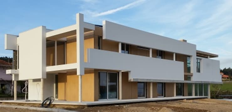 Casa de Agilde: Casas  por Hugo Pereira Arquitetos