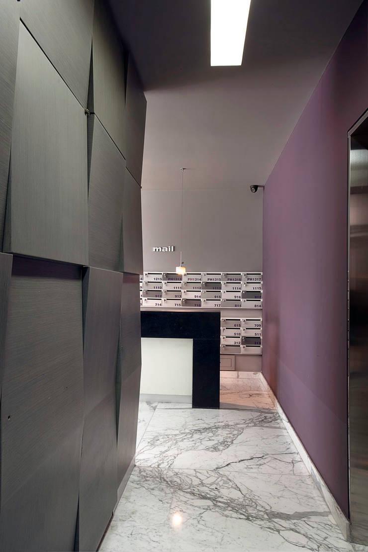 Pasillos y vestíbulos de estilo  por ARCO Arquitectura Contemporánea