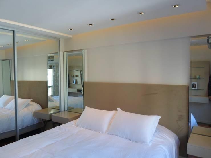 Dormitorio Suite: Dormitorios de estilo  por Estudio BASS Arquitectura
