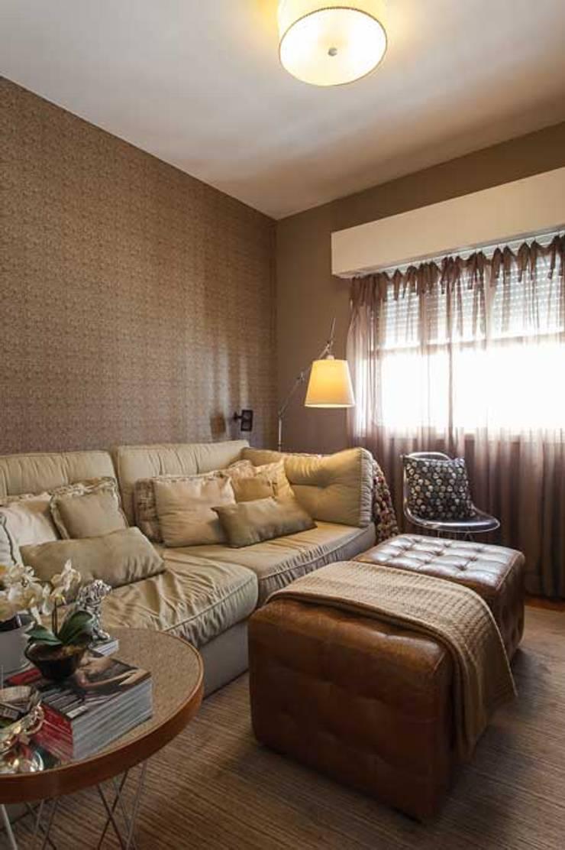 Sala de TV: Salas de estar  por Piloni Arquitetura