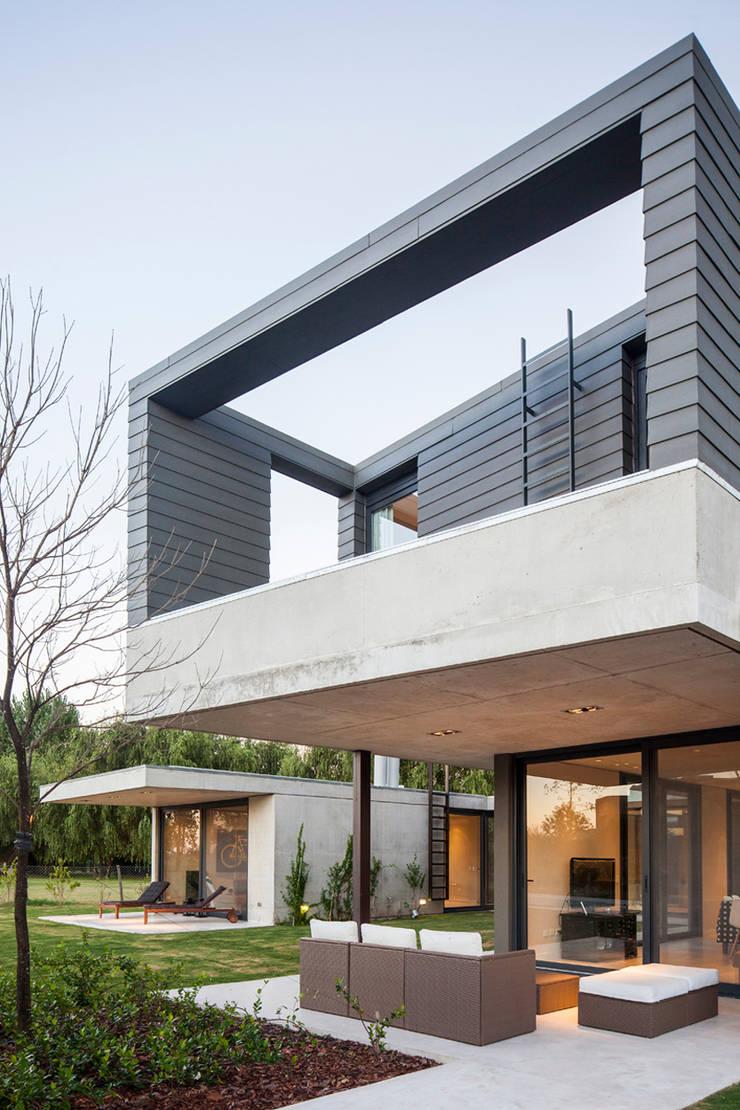 Vivienda Unifamiliar: Casas de estilo  por ACArqs,