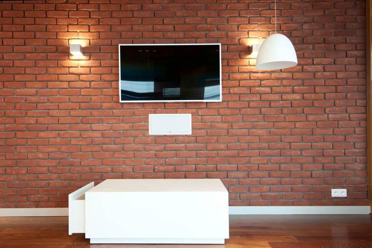 19 Dzielnica: styl , w kategorii Salon zaprojektowany przez FusionDesign,Nowoczesny Cegły