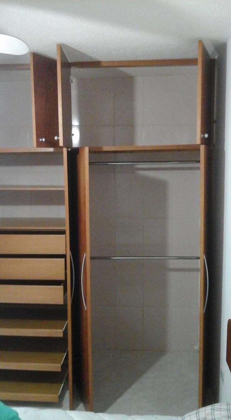 Trabajo de carpintería: Dormitorios de estilo  por Diseño y Carpinteria Transfomic, C.A.