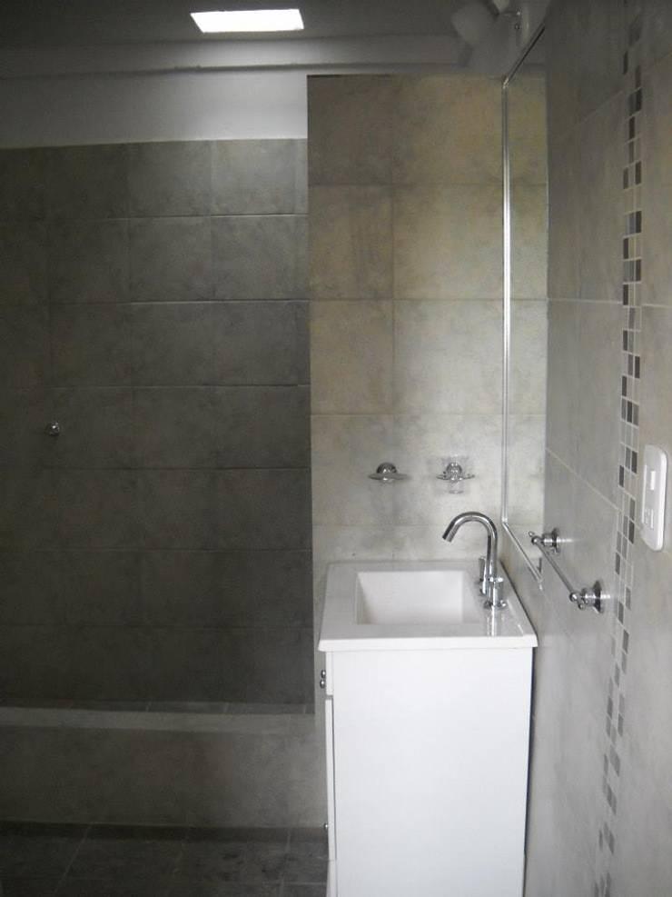 Baños: Baños de estilo  por Arquitectura IPC