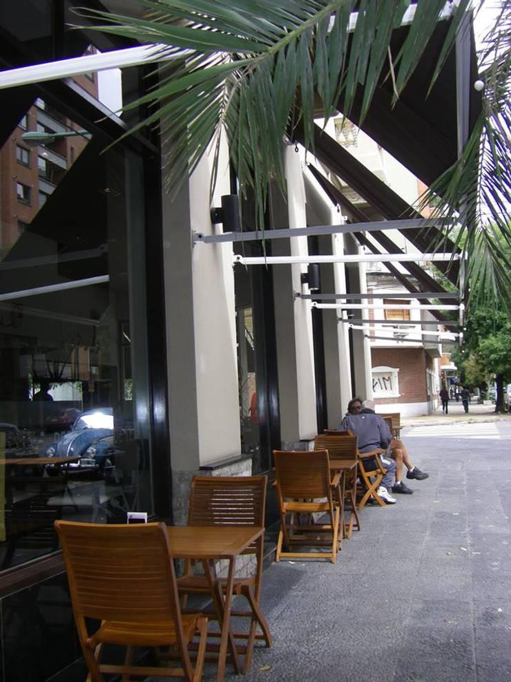 ESTILO MISION: Bares y Clubs de estilo  por AyD Arquitectura SRL,