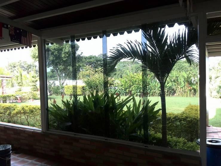 Ventanas: Puertas y ventanas de estilo  por cristaleria el recreo c.a