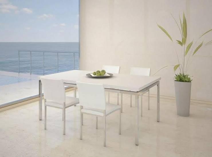 Amoblamientos en ambientes: Comedores de estilo  por Grundnig Haus Amoblamientos