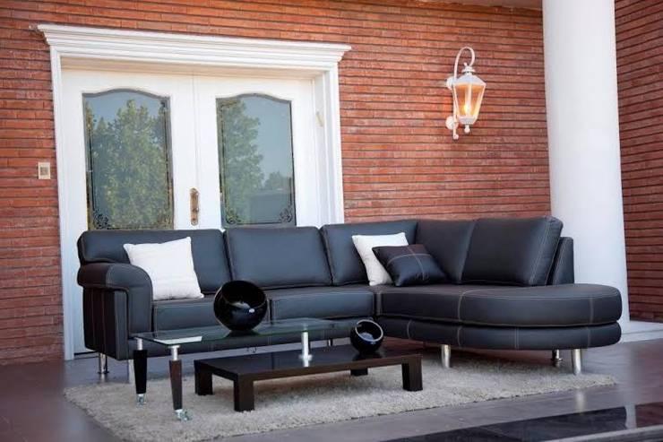 Amoblamientos en ambientes: Livings de estilo  por Grundnig Haus Amoblamientos