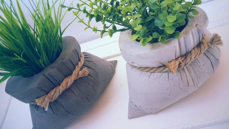 Bolsa de cemento: Hogar de estilo  por EssE deconcreto
