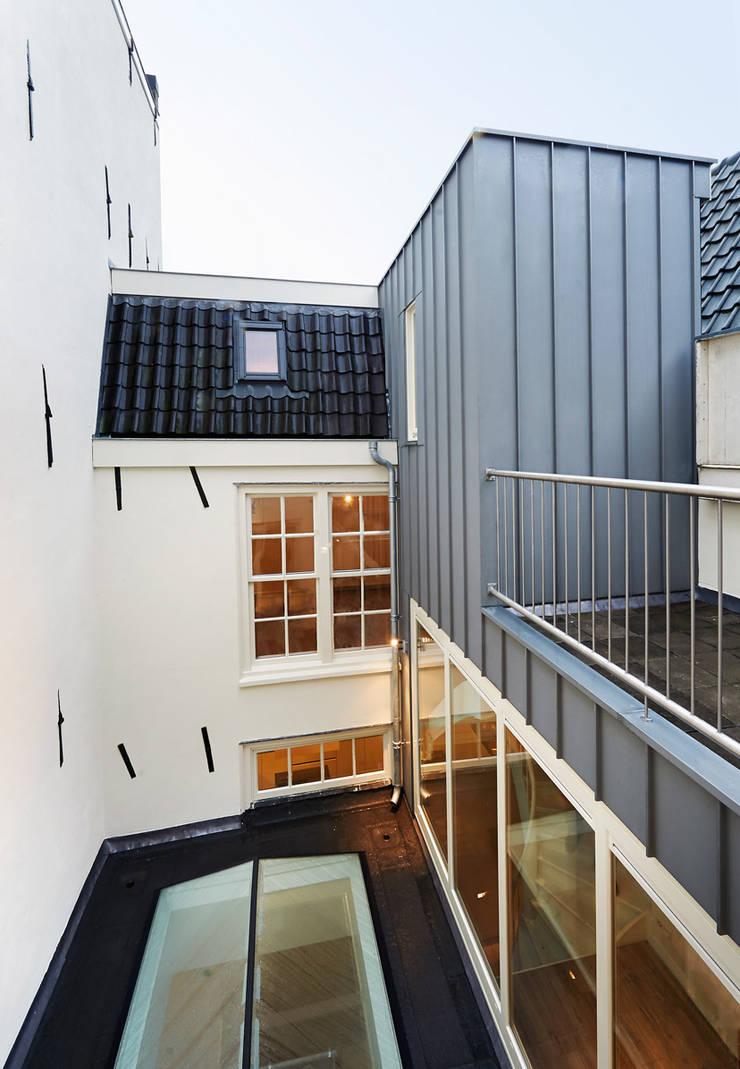 Binnenhof:  Huizen door Architectenbureau Vroom
