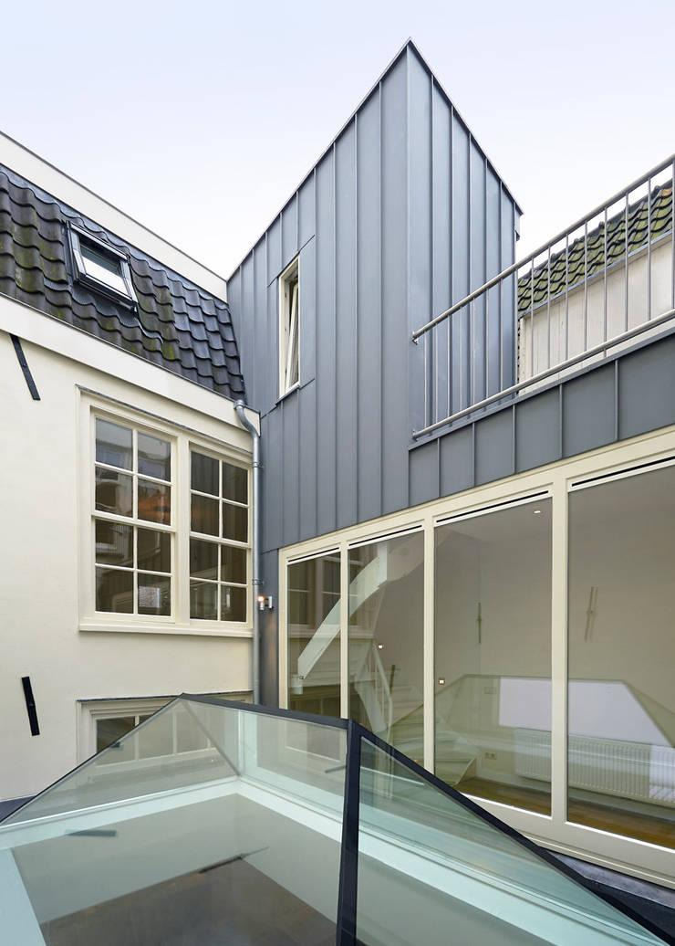 Herboren aan de grachtengordel:  Huizen door Architectenbureau Vroom