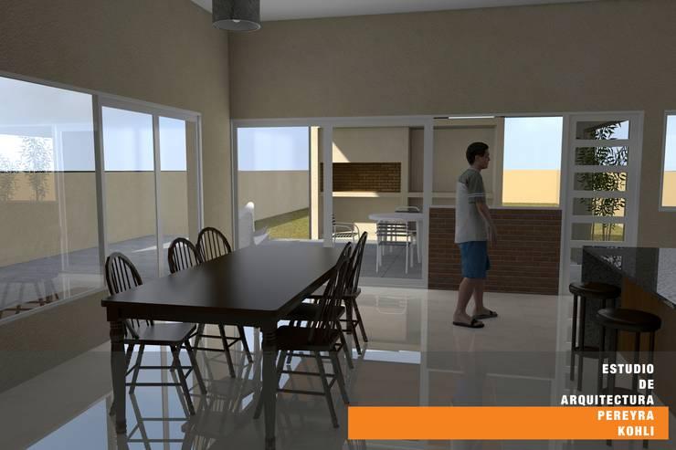 Dining room by Estudio de Arquitectura Pereyra Kohli