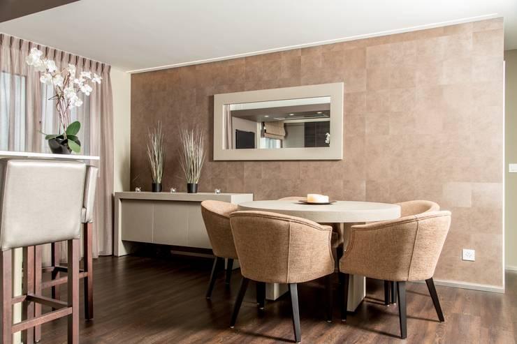Création d'un appartement en copropriété: Salle à manger de style de style Moderne par CSInterieur