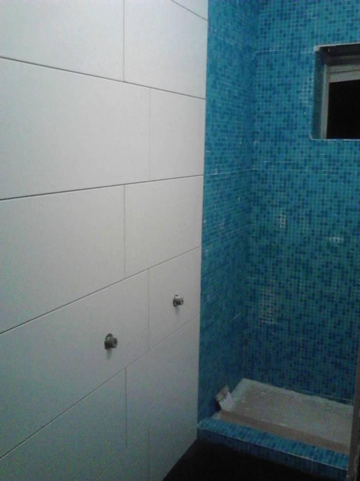 Renovação de w.c: Casas de banho  por Officina de Interiores