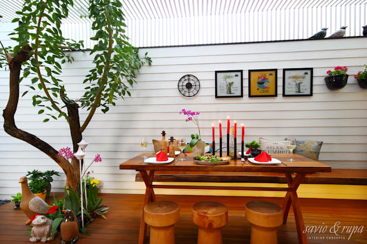 Dining room by Savio and Rupa Interior Concepts ,