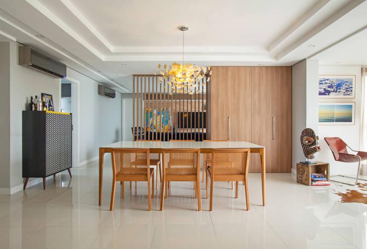 Dining room by Johnny Thomsen Arquitetura e Design