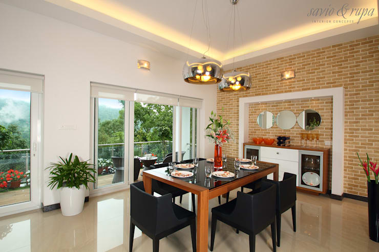 Dining room:  Dining room by Savio and Rupa Interior Concepts