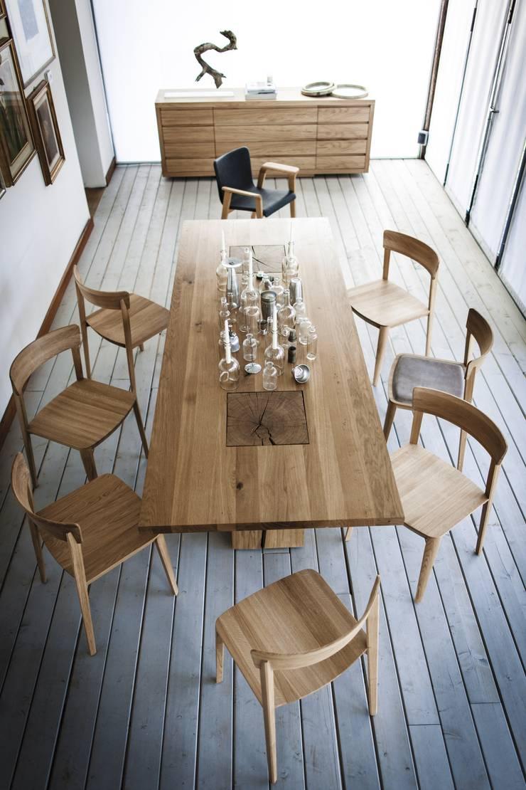 Boss Executive design C.R.&S. Riva1920: Sala da pranzo in stile  di Riva1920