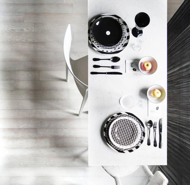 casaEsse: Sala da pranzo in stile in stile Minimalista di LDA.iMdA architetti associati