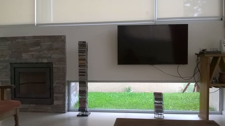 Soleloir: Salas multimedia de estilo  por Arq Andrea Mei   - C O M E I -,Moderno