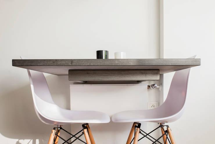 SŁONECZNA KUCHNIA: styl , w kategorii Kuchnia zaprojektowany przez Kokon Studio Karolina Alicja Prałat,Minimalistyczny Kamień