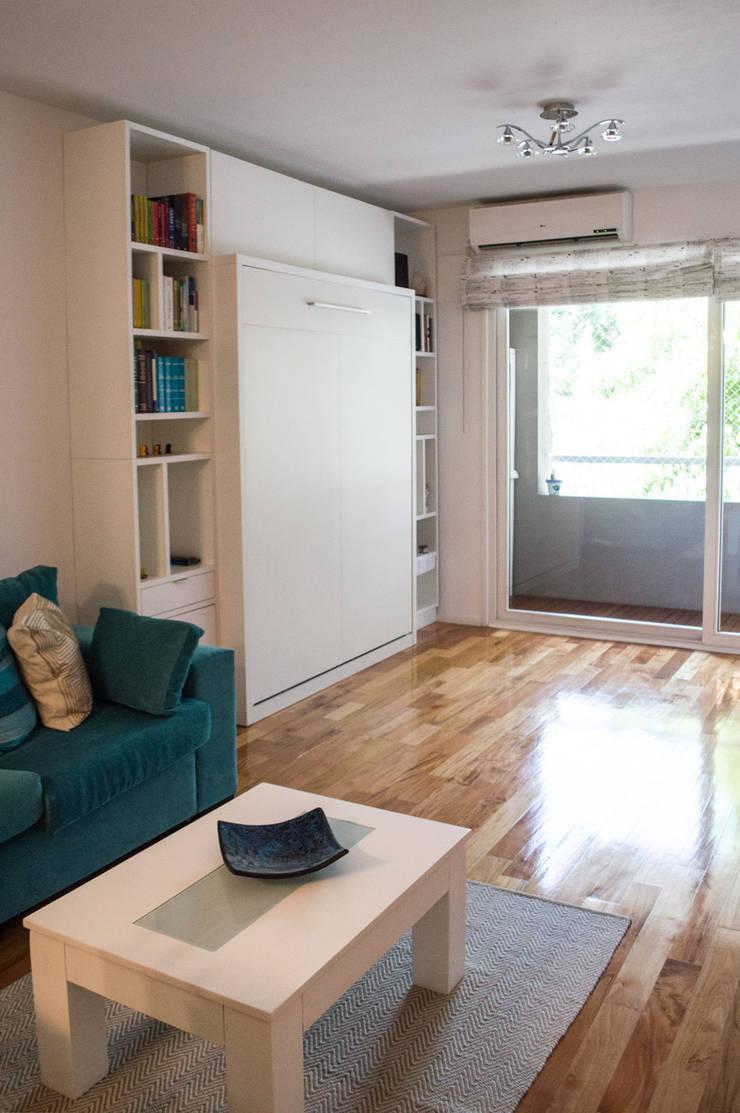 Biblioteca + Cama rebatible: Livings de estilo  por MINBAI