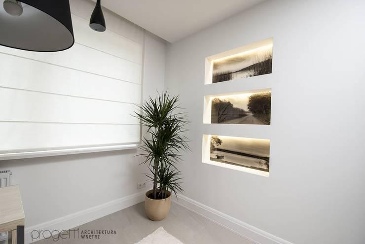 Gabinet: styl , w kategorii Domowe biuro i gabinet zaprojektowany przez Progetti Architektura,Klasyczny