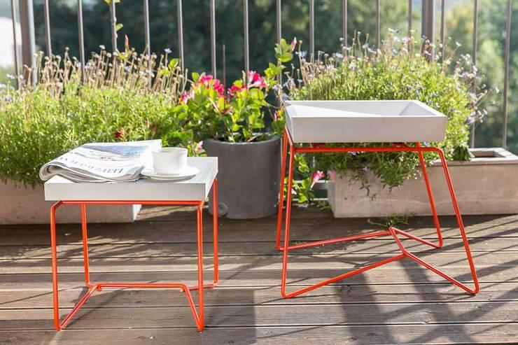 Balcones, porches y terrazas de estilo  por BETONIU GmbH