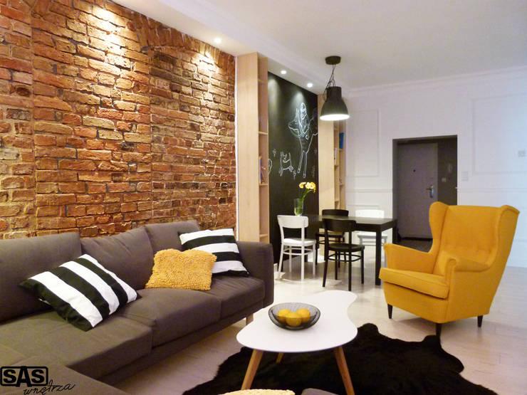 Projekt mieszkania na wynajem w Zielonej Górze: styl , w kategorii Salon zaprojektowany przez SAS