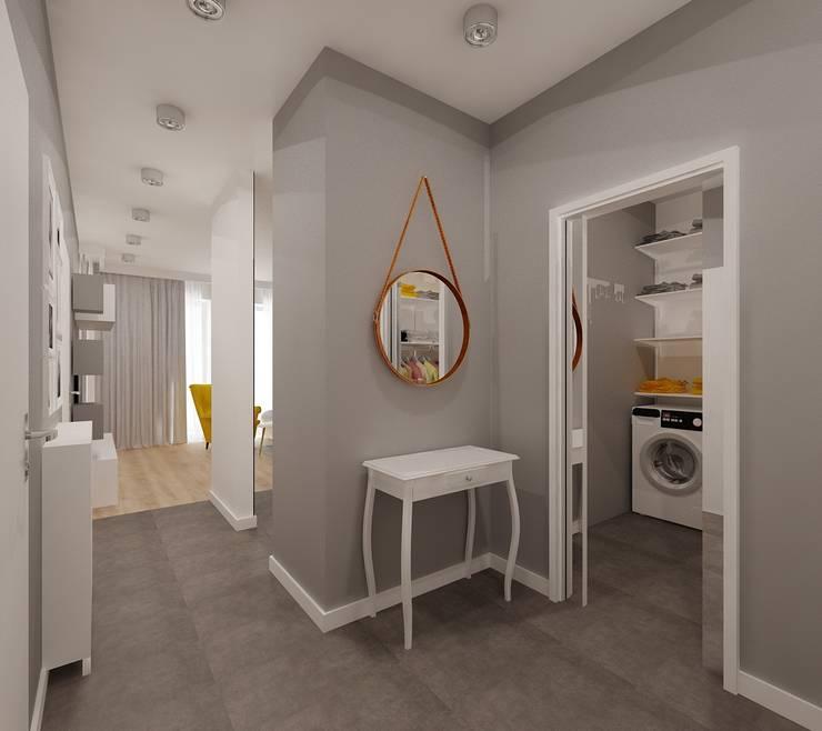 Stonowane mieszkanie 45m2 w Dąbrowie Górniczej : styl , w kategorii Korytarz, przedpokój zaprojektowany przez Ale design Grzegorz Grzywacz